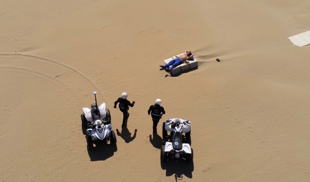 Italian police with Anafi drone fine sunbather on deserted beach