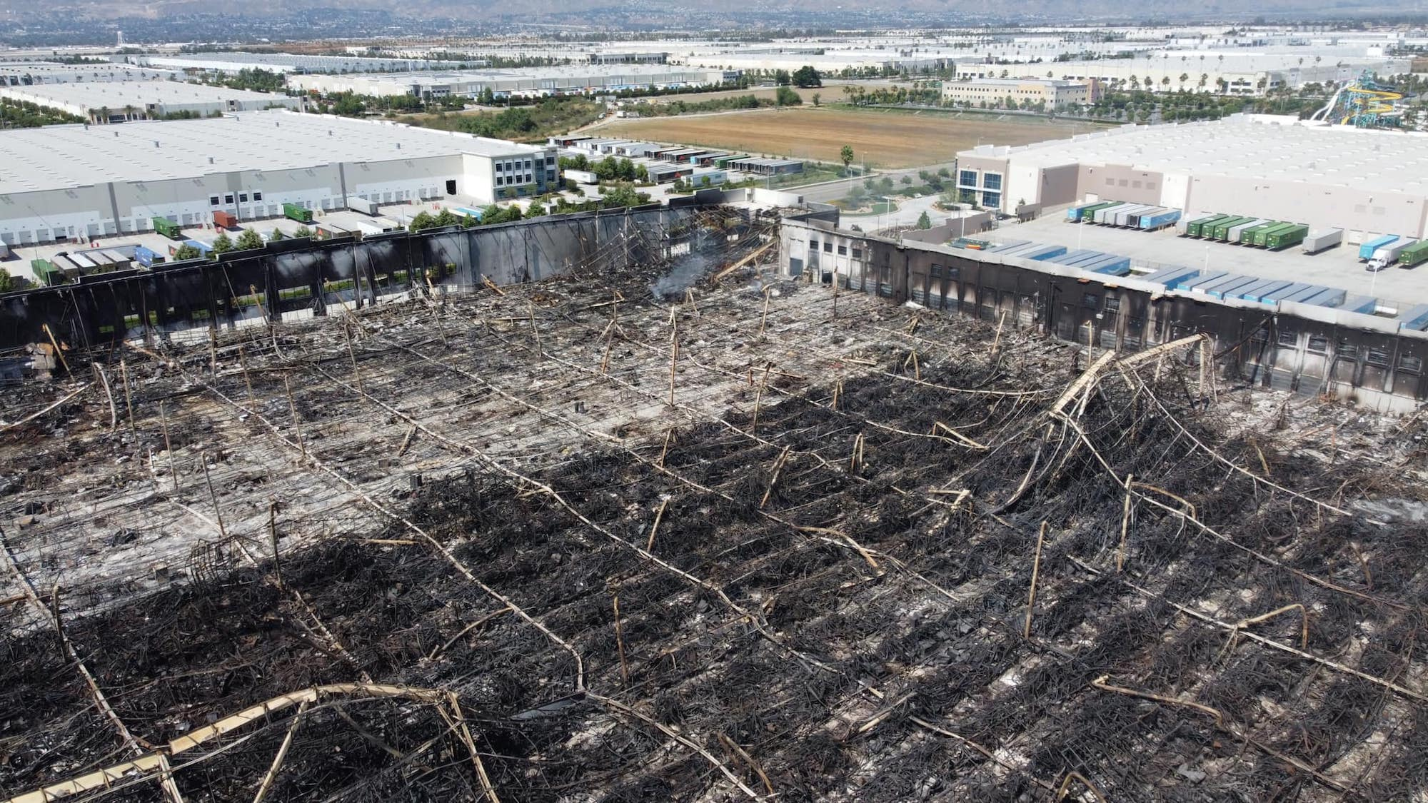 Drone photos show burned-down Amazon distribution center in Redlands, California