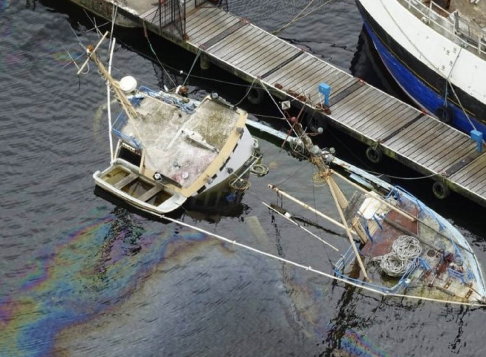 Drone photos show extend of oil spill after boats sinks