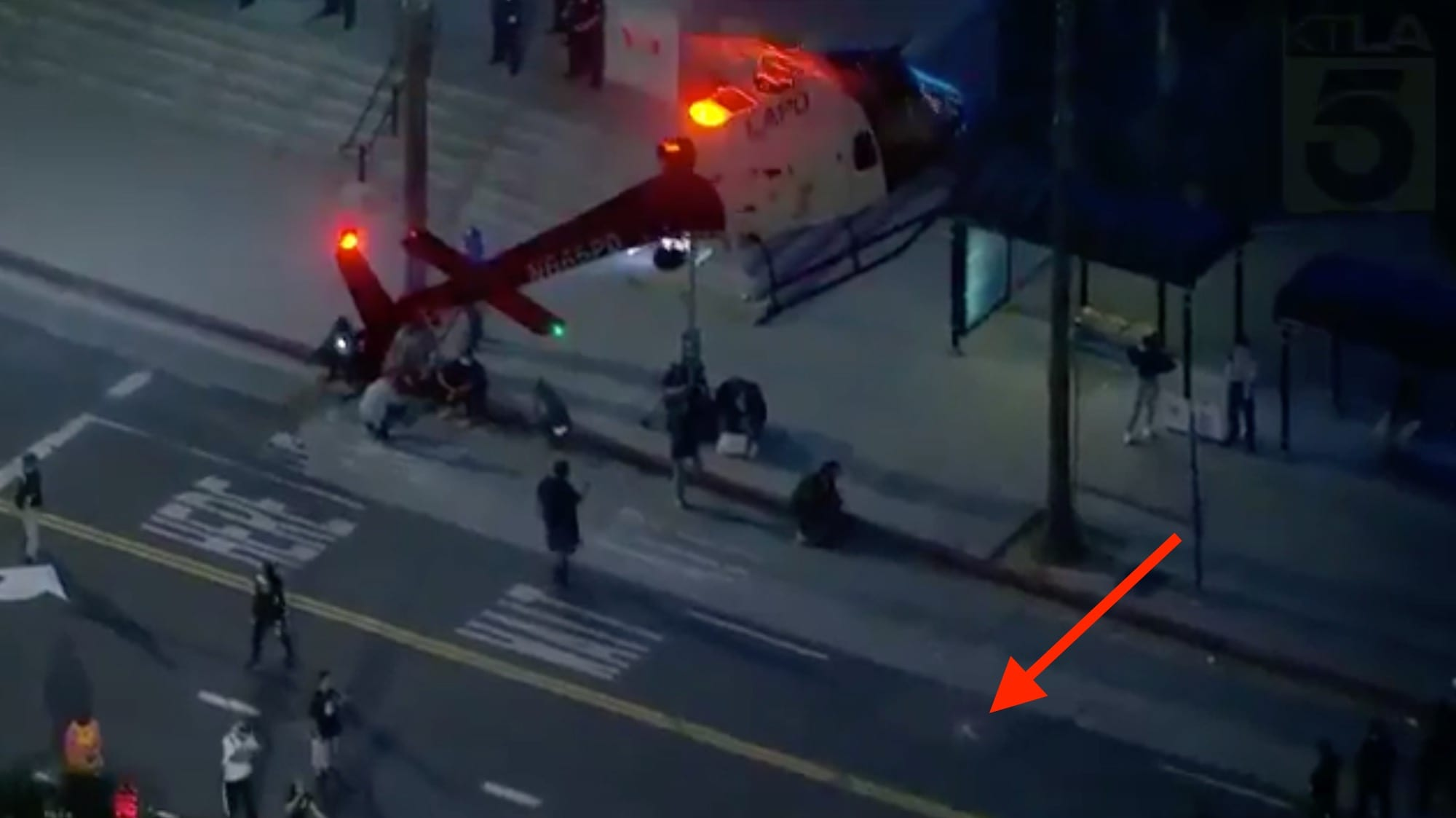 Police helicopter tries to force down drone amidst protests in Los Angeles