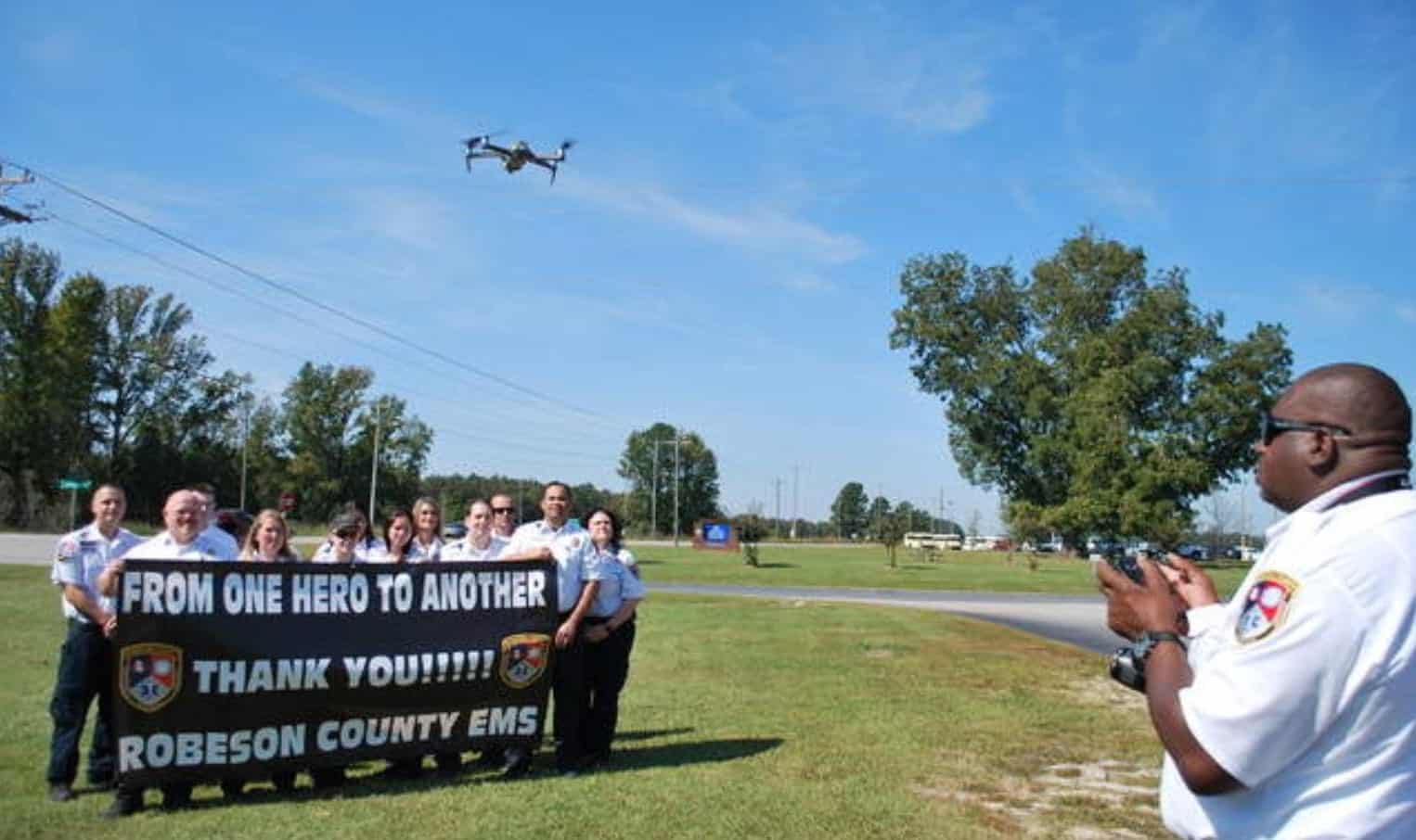 Drone group photo of EMS workers outside Robeson County Emergency Operations Center