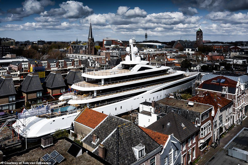 Drone video shows superyacht Viva passing through narrow canals in Holland